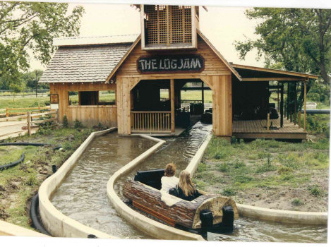 Riders return to the loading area after a ride on the Log Jam