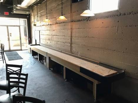 Shuffleboard at District Taque